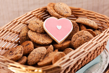 Heart shaped cookie for valentines day into basket Stock Photo