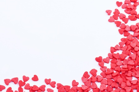 Frame made of small red hearts on the white background Stock Photo - 17248934