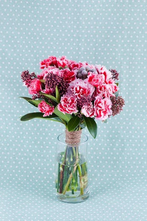 closeup pink carnations bouquet of flowers in vase