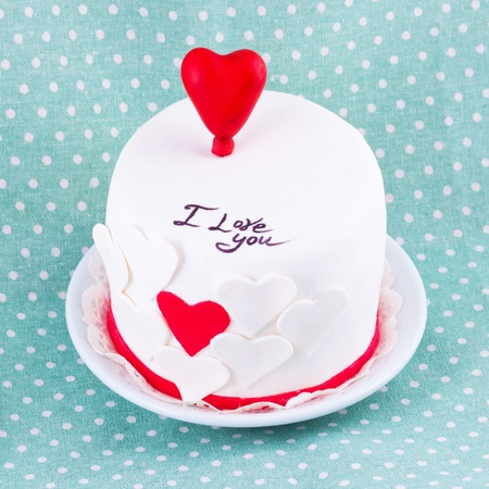 cake for valentine s day on blue doted background Stock Photo - 17740812