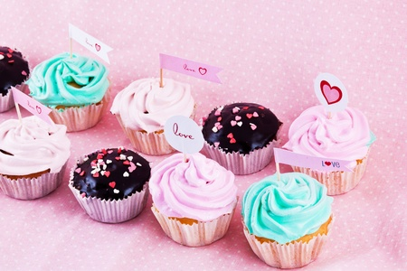 choloate cupcakes with hearts on pink background