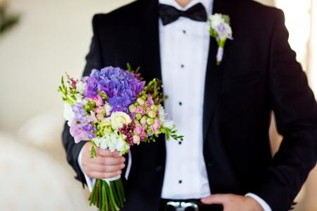 groom with beautiful flowers Stock Photo