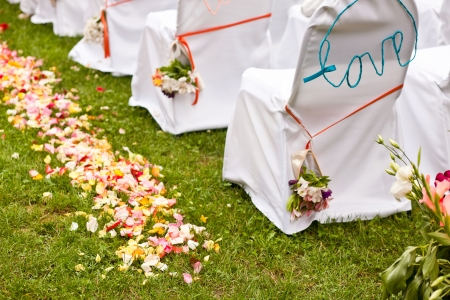 wedding chairs: White wedding chairs decorated with red bows Stock Photo