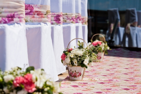 flowers compositions in basket on wedding ceremony