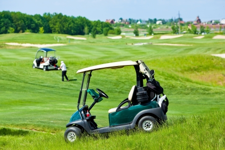 Golf club cars at golf field photo