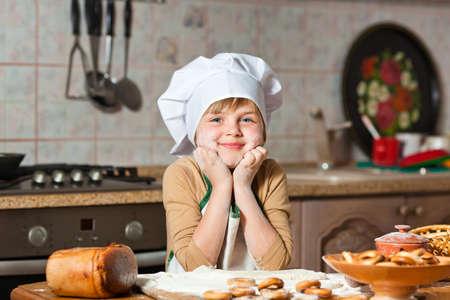 Cute girl baking cookies Stock Photo