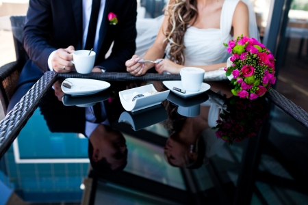 lovers holding hands on the table in cafe