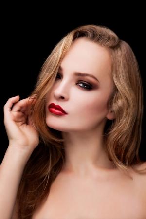 A beautifu girl with fashion make-up on black background Stock Photo
