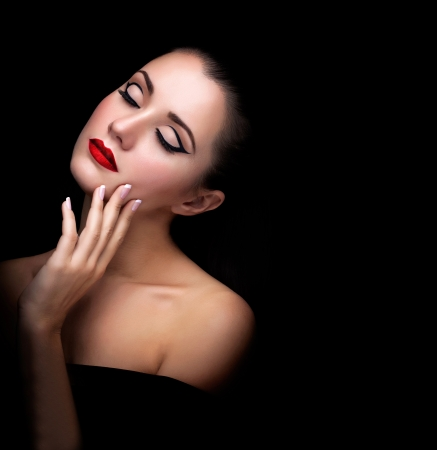 A beautifu girl with fashion make-up on black background photo