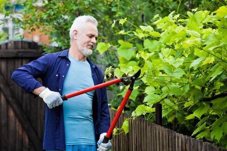 Portrait of senior man gardening 스톡 콘텐츠