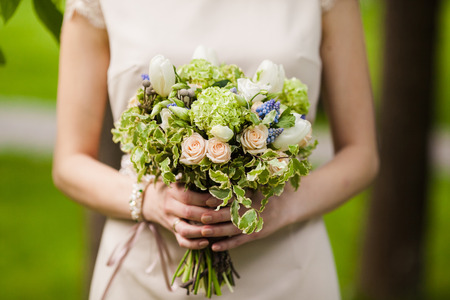 Closeup of brides flowers on wedding day