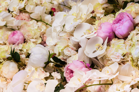 Floral background. Lot of artificial flowers in colorful