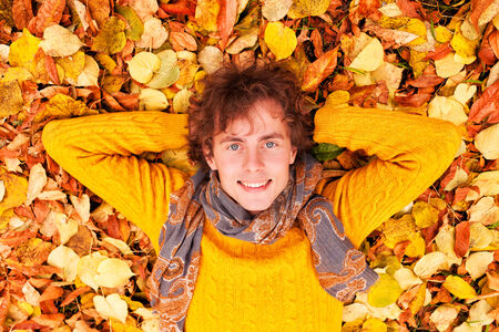 man with curly hair in autumn Stock Photo