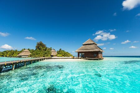 small tropical island with beach villas