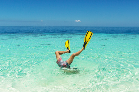 diver jump to the whater with flippers on his legs Standard-Bild
