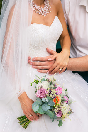 groom and bride with beautiful wedding bouquet
