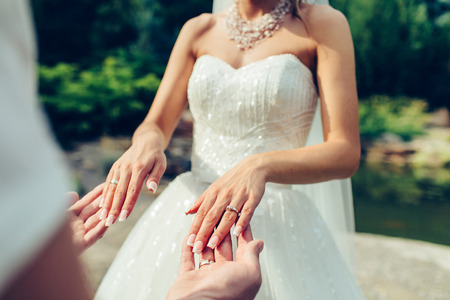 groom holding a brides hands outdoor