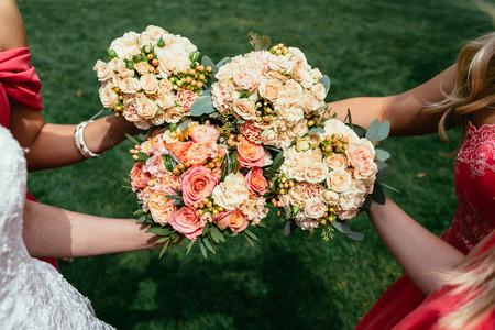 bridesmaids: bride and bridesmaids holding Wedding bouquets