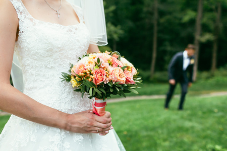 bride holding Wedding bouquets and waiting comming groom