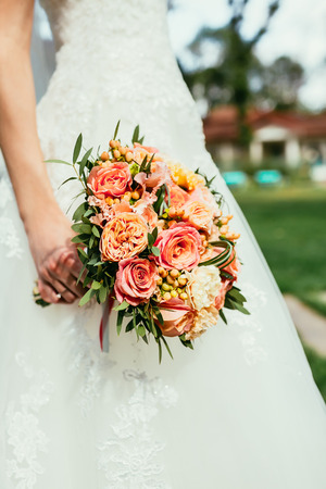 bride holding Wedding bouquets. Vertical picture