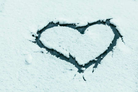 frash: Heart symbol on snowy car glass with frash winter snow
