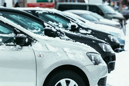 Cars covered with fresh white snow in winter time