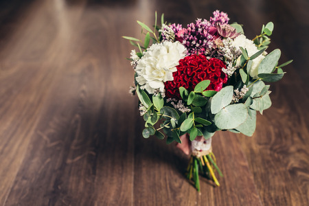 Rustic wedding bouquet on wooden background