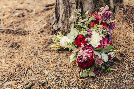 Rustic wedding bouquet of red rose with cope space