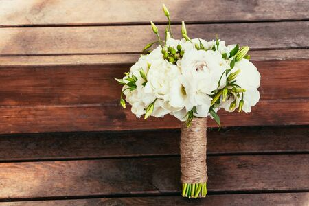 Rustic wedding bouquet on brown wooden backgraund on ceremony place with copy space Stock Photo