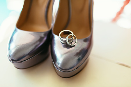 silvering bride shoes with wedding rings