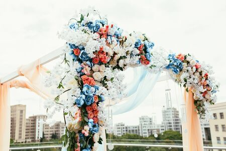 Wedding archway with flowers arranged in city for a wedding ceremony