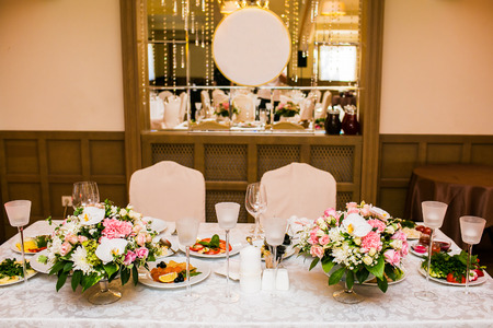 wedding table decorations on banquet with flowers