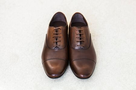 Brown wedding leather mens shoes. Top view, close-up. Stock Photo