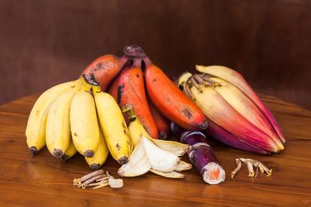 bunch of hearts: Very fresh banana bunch with unripe banana, wooden table Stock Photo