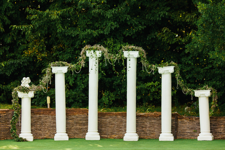 Decorated columns ahead of trees