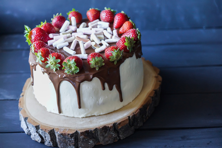 strawberry: Delicious cake with fresh strawberry and dark chocolate decoration Stock Photo