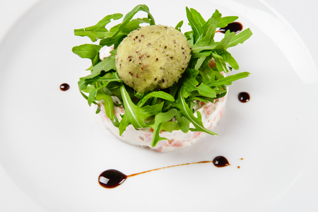 Tartar from salmon with creamy pine-nuts, kiwi and lemon sorbet. Stock Photo
