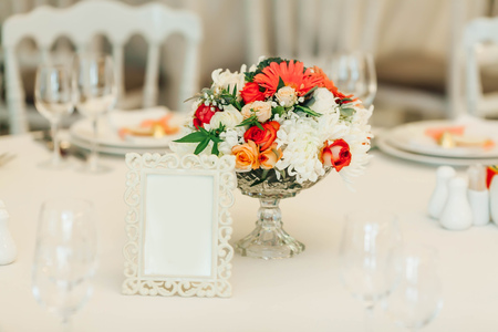 Table decor with flowers table numbers. Wedding banquet decoration. Copy space. Close-up