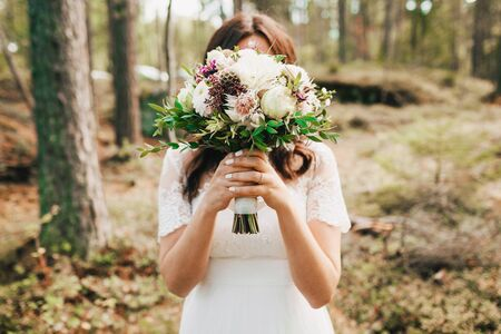 Bride Covering Her Face With Bouquet. Artwork. Close-up