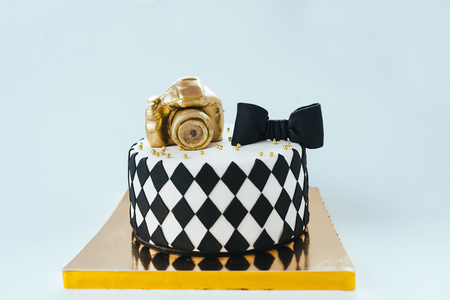 Black and White Birthday Cake For Photographer On Bright Background.