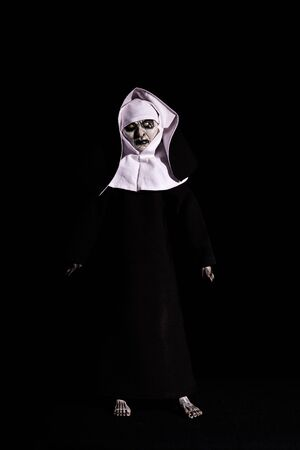 scary nun. Halloween concept. horror. fear. isolated on black background 스톡 콘텐츠