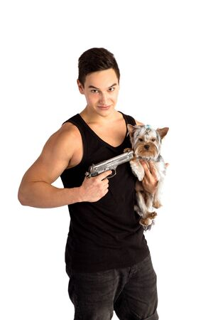 the guy is holding a dog in his arms. threatens her with a gun. isolated on white background