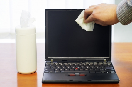 wiping cleaning process of mobile personal computer laptop screen monitor with napkins