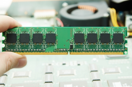 dimm: Hand holding computer memory