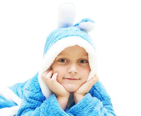 Child in blue bathrobe Standard-Bild