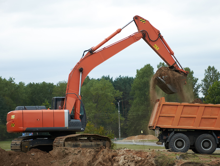 Excavator Loading Dumper Truck photo
