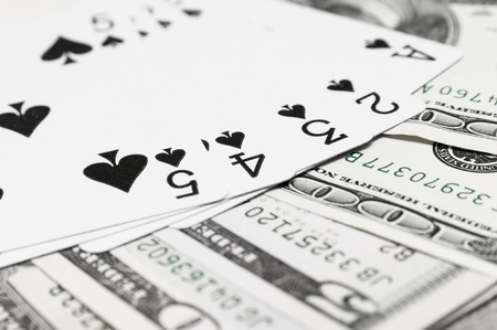 Playing Cards and Cash Stock Photo
