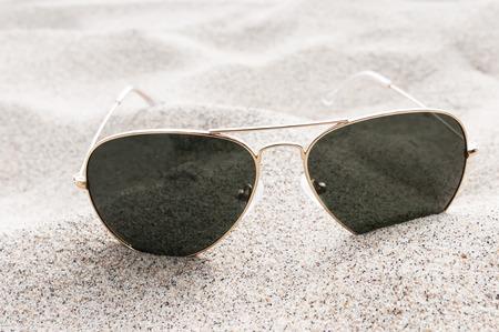 Sunglasses on the sand Standard-Bild