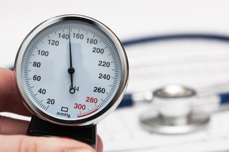 sphygmomanometer: Sphygmomanometer in mans hand Stock Photo