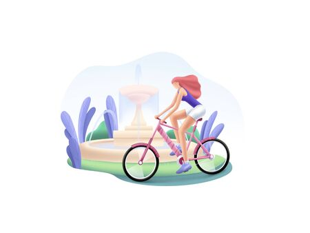 Girl rides the bicycle in the park